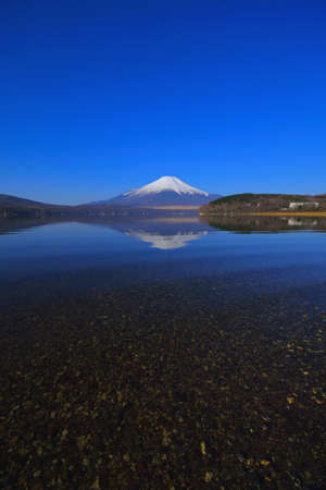 Mt. Fuji of Transparent water with Blue Sky from Lake Yamanakako Japan