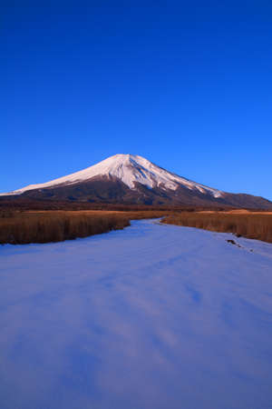 Mount Fuji with blue sky of snowy landscape from Nashigahara Yamanashi Prefecture Japan 02 / 03 / 2019