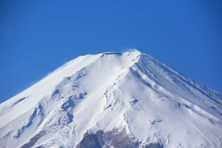 White Mt. Fuji with blue sky from Fujiyoshida City Japan