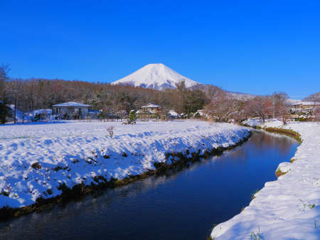 Mt. Fuji in snowy scenery from Shinnasyo River in Oshino Village Japan