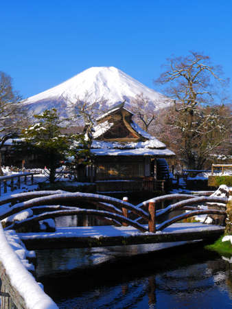 World Heritage site, Mt. Fuji with snow scenery of Oshino Hakkai Japan 04/14/2020 免版税图像 - 144818207