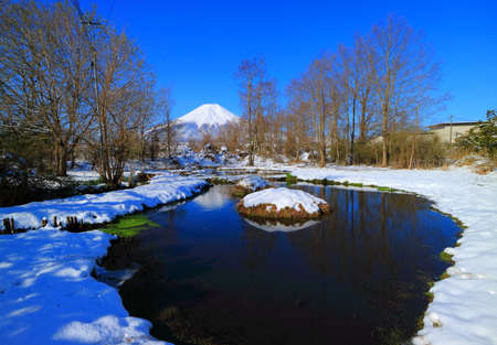 Hotokedojo Pond Snowy and Mount Fuji in Oshino Vollage Yamanashi Japan 04/14/2020