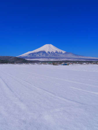 Mt.Fuji in April with a clear blue sky and snowy scenery from Oshino Village Japan 04/14/2020
