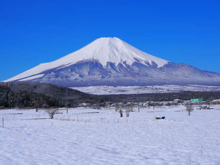 Mt. Fuji in snowy scenery from Oshino Village Yamanashi Japan 04/14/2020 免版税图像