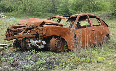 crashed: An abandoned and rusted car