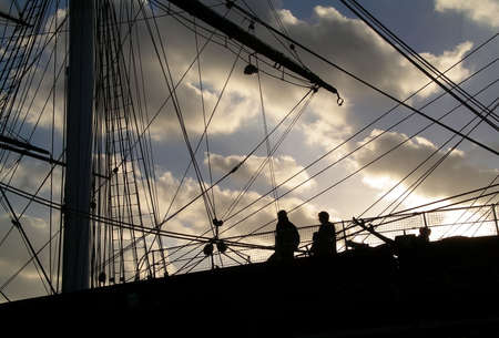 greenwich: A view of tourists visiting the Cutty Sark in Greenwich, London at sunset. Stock Photo
