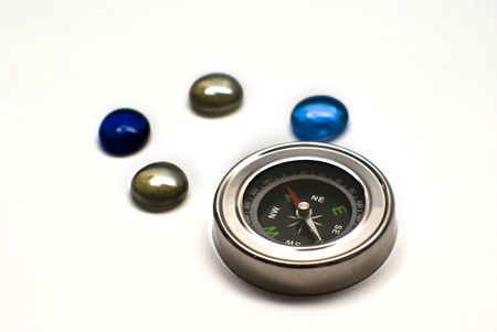 mondo: compass with colored stones Stock Photo