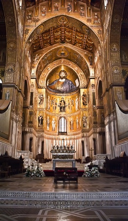 Medieval Norman architecture. Cathedral of Monreale, interior with its golden mosaics.