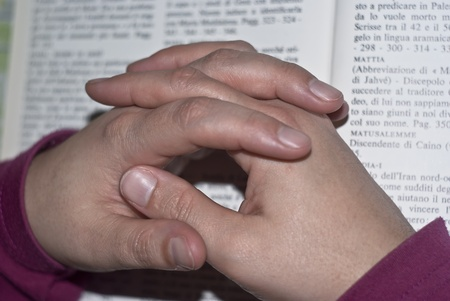 Hands in prayer of woman over the bible. photo