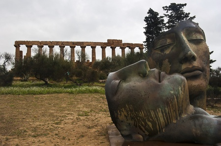 Greek temple of Agrigento with modern sculture. Sicily- Italy photo