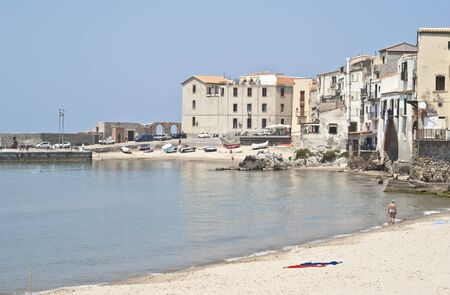 Cefalu Beach with old buildings and clear  blue sky. Sicily  photo