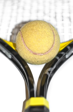 Tennis ball and racket isolated on white background Stock Photo - 14132860