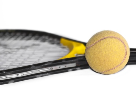 Tennis ball and racket isolated on white background photo