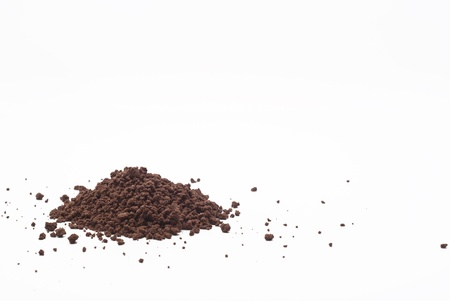 Grains and cocoa powder on a white background. photo