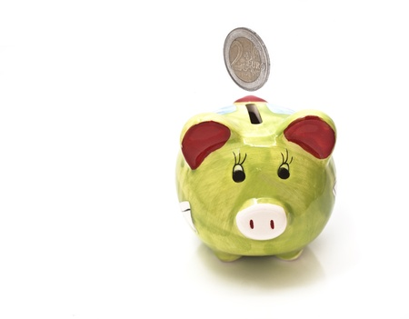 Pretty piggy bank empty, isolated in white background. Financial crisis concept photo