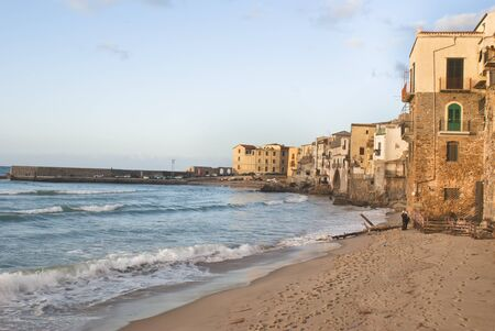 beach of Cefalu with centre city in the background. Sicily photo