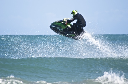 water  skier: man jumps on the jet ski above the water at Mondello. Sicily