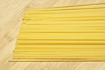 spaghetti pasta on wooden board Stock Photo - 14400072