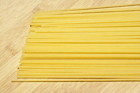 spaghetti pasta on wooden board Stock Photo - 14400072