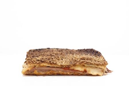 Sicilian Rorisserie. piece of rotisserie with mozzarella and tomato sauce isolated on white. photo