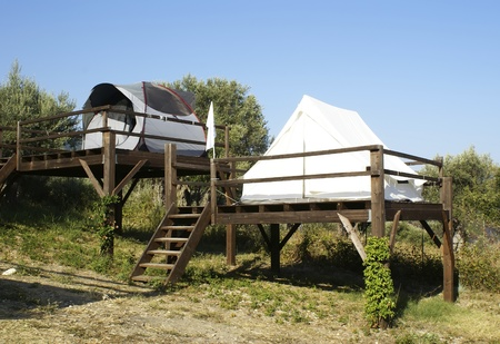 stilts: tents on stilts over the blue sky and countryside. Camping