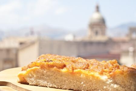 sicilian traditional pizza sfincione over backgroun of palermo.