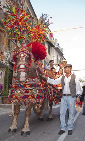 POLIZZI GENEROSA, SICILY - AUGUST 19:Folkloristic parade of traditional horse-cart in Sicily during the