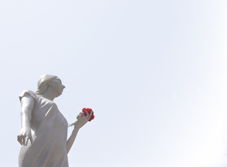 santa rosalia: Sculpture of santa rosalia with red rose in hand isolated on white background. Palermo, Sicily Stock Photo