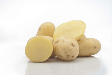 New potatoes isolated on white background photo
