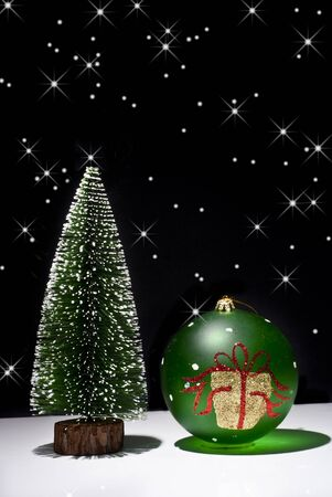 Christmas Tree and Christmas ball on a black background with stars photo