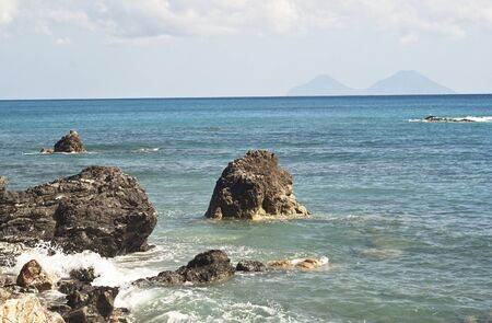 alicudi: view of the Aeolian Islands from the Brolo beach in the province of Messina, Sicily