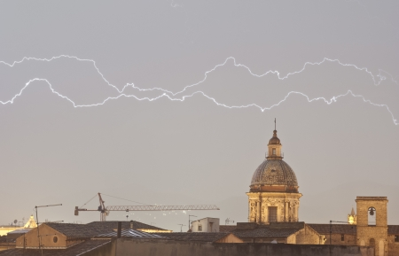 Parallel lightning over urban houses in Palemo, Sicily, Italy photo