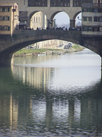 vechio: The Ponte Vecchio  is a Medieval bridge over the Arno River at evening. Florence, Tuscany, Italy. Editorial