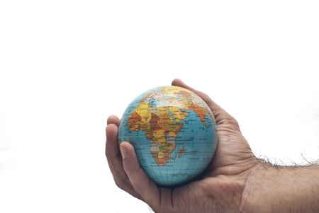 Globe ,earth in human hand, isolated on white photo