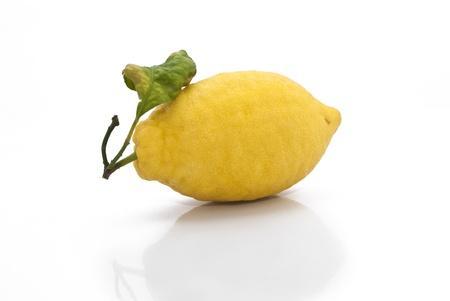 yellow sicilian fresh lemon isolated on a white background