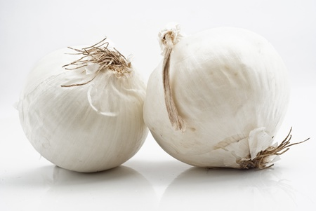 pealing: Fresh white onions isolated on white