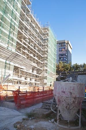 High-rise building construction site against blue sky photo
