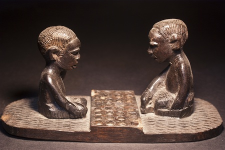 African wooden figures depicting a game of checkers photo