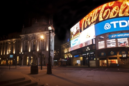 tdk: LONDON, ENGLAND APRIL 18: Famous Piccadilly Circus neon signage that has become a major attraction of London on April 18, 2013 in London, United Kingdom.