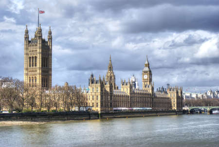 London. Beautiful view of government Houses of Parliament and big ben with Thames river photo