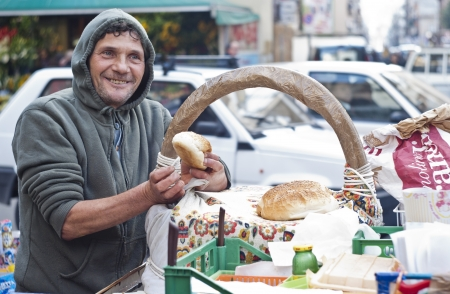PALERMO - DECEMBER 29: Man sells Frittola on the local market in Palermo, called Ballaro. This market is also tourist attraction in Palermo, Sicily, Italy on Dec. 29, 2012. Editorial