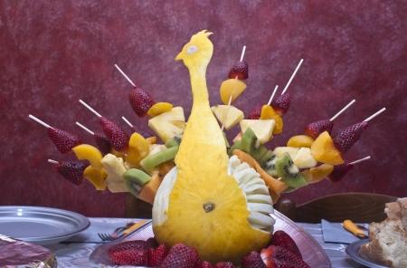 Peacock fruit, fruit buffet: kiwi, strawberries, peaches, melon, pineapple