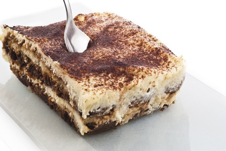 Tiramisu - Italian layered dessert, consisting of the following ingredients: mascarpone cheese, coffee (usually espresso), eggs, sugar and biscuits Savoyardy. Typically, dessert sprinkled cocoa powder photo