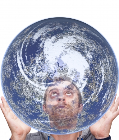man holds the earth and looks inside photo