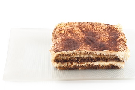 sprinkled: Tiramisu - Italian layered dessert, consisting of the following ingredients: mascarpone cheese, coffee (usually espresso), eggs, sugar and biscuits Savoyardy. Typically, dessert sprinkled cocoa powder Stock Photo