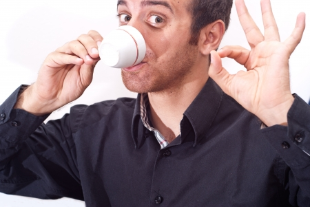 Close up portrait of a businessman drinking coffee isolatrd on white Stock Photo