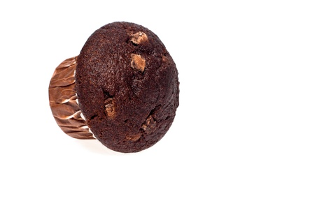 Close up of a fresh baked chocolate muffin against a white background Stock Photo - 21447055