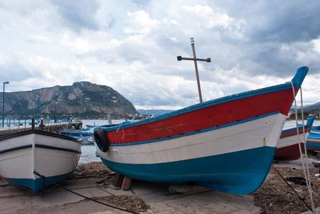 mondello: Old boats in Mondello beach. Palermo, Sicily, Italy