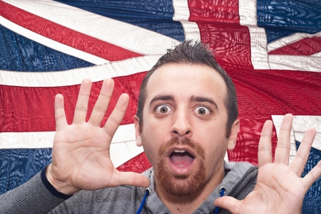 man with open mouth isolated on britain flag background as symbol of values like teaching, learning, multilingual speaking different of languages photo