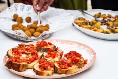 Bruschette and olive ascolane. Italian appetizers Stock Photo